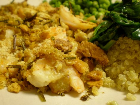 Baked stuffed shrimp with quinoa, spinach and peas